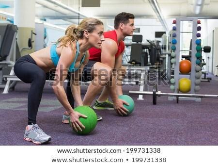 Trening siłowy człowiek muzyka piłka ściany fitness Zdjęcia stock © Maridav