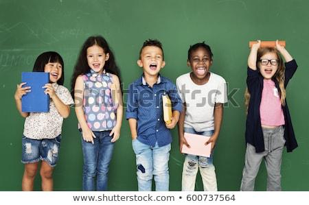 Одноклассники девочек чтение книгах дети Сток-фото © robuart