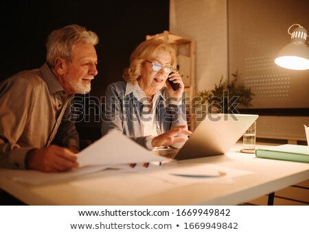 Businesswoman on the phone next to her partner Stock photo © photography33