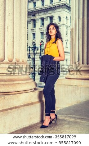 Young lady wearing orange high-heels Stock photo © konradbak
