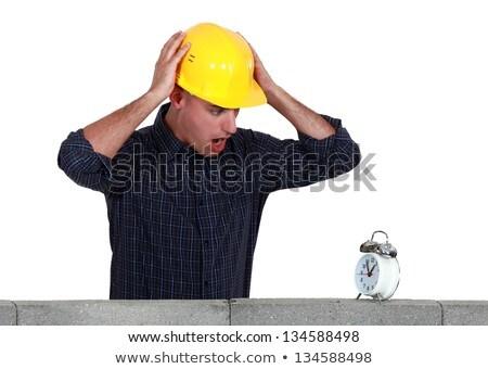 Panicked mason looking at an alarm clock Stock photo © photography33