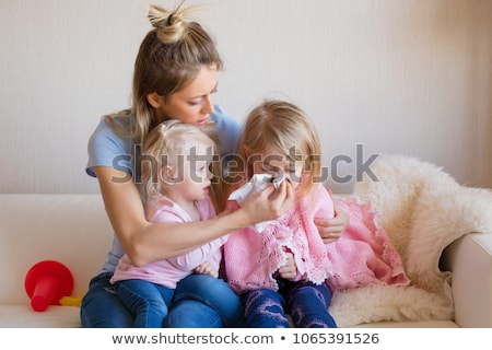 Stock photo: Mother taking care of her small child at home
