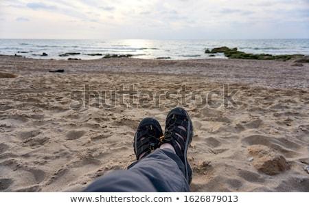 moço · relaxante · praia · homem · mar · verão - foto stock © pressmaster