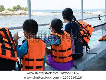 mother with the daughter they sit on the inflatable boat Stock photo © Paha_L