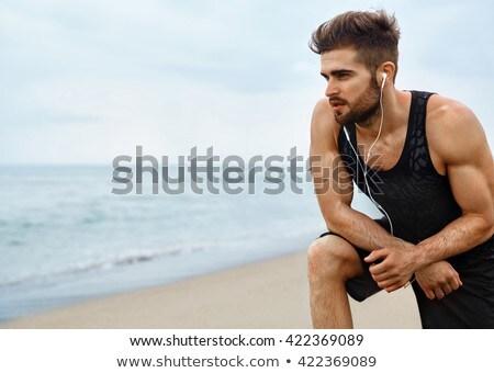 Sfinito uomo break jogging spiaggia Foto d'archivio © wavebreak_media