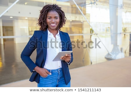 Business woman using mobile outside Stock photo © IS2