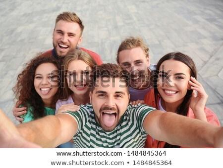 Gruppe · glücklich · Freunde · posiert · Veröffentlichung · Mann - stock foto © wavebreak_media