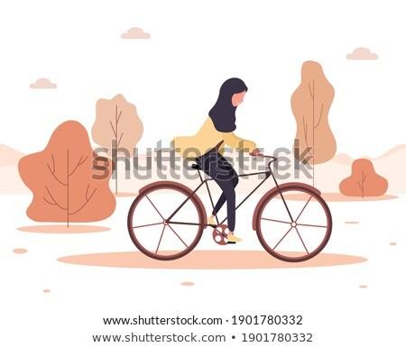 Arab vrouwen oranje fiets ingesteld Stockfoto © toyotoyo