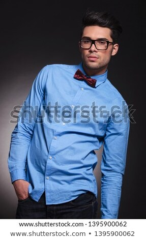 smiling elegant man wearing glasses stands with hand in pocket  Stock photo © feedough