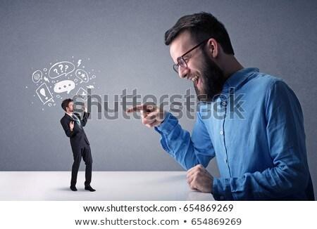 Jungen Geschäftsmann kämpfen Miniatur professionelle böse Stock foto © ra2studio