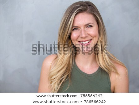 Beauty portrait of an attractive young blonde woman Stock photo © deandrobot