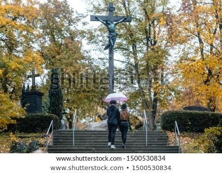 Homme femme marche up étapes cimetière Photo stock © Kzenon