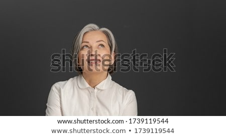 Portrait of confident business woman looking up-right. Stock photo © lichtmeister