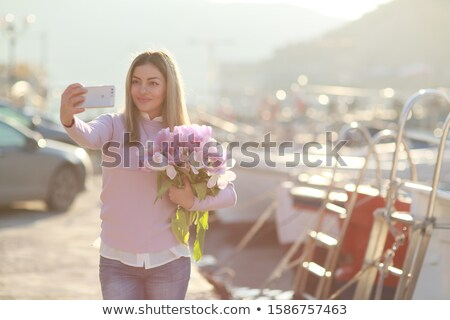 Young woman in jeans on tourist trip in seaport Stock photo © ElenaBatkova