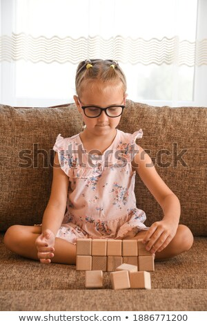 little girl with diary sitting on sofa at home Stock photo © dolgachov