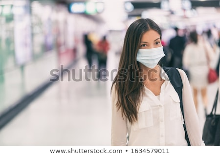 Woman in face medical mask protected from flying virus with protection shell, world epidemy concept Stock photo © robuart
