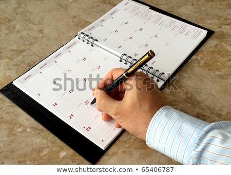 Homem enchimento fora mensal tabela Foto stock © yoshiyayo