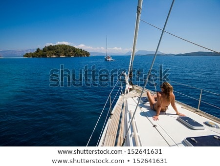 Young woman sailing on luxury yacht stock photo © CandyboxPhoto