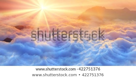 sunrise with clouds over sea stock photo © mikko