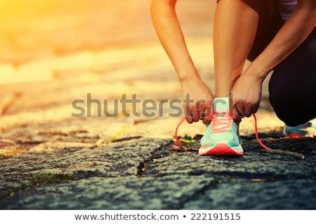 Fiatal nő sportok cipők út fitnessz fut Stock fotó © luckyraccoon