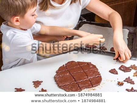 Gingerbread figures on a baking sheet stock photo © olandsfokus
