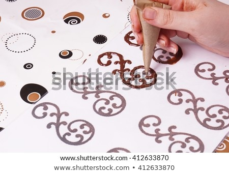 hands on dessert chef who makes chocolate scrolls stock photo © klinker