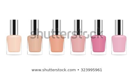 Woman with nail polish tube isolated on white Stock photo © Elnur