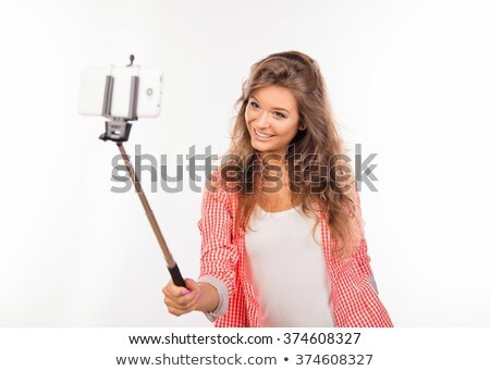 happy woman in shirt making selfie on phone stock photo © deandrobot