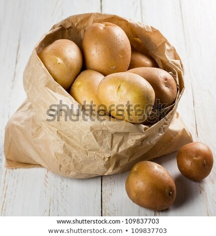 New potatoes in paper bag stock photo © Hofmeester