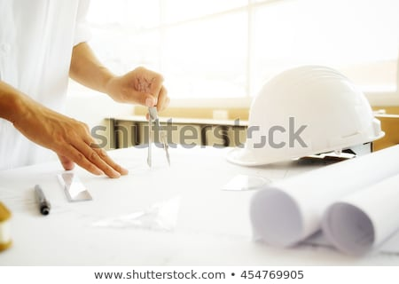 architects with blueprint and helmets at office Stock photo © dolgachov