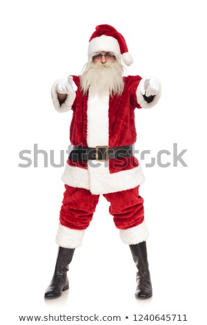 merry santa claus pointing fingers while standing with parted fe Stock photo © feedough