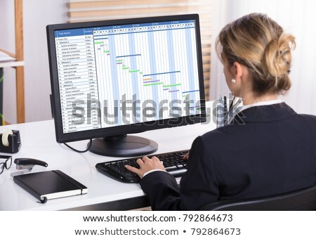Businesswoman Analyzing Gantt Chart On Computer Stock photo © AndreyPopov