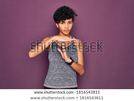 portrait of a confident young african sportswoman stock photo © deandrobot