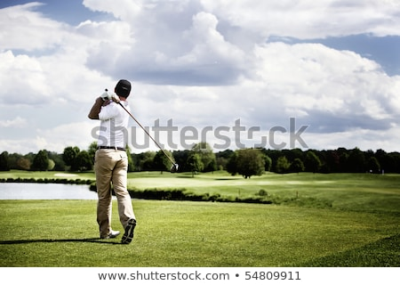 Man teeing-off golf ball. Stock photo © lichtmeister