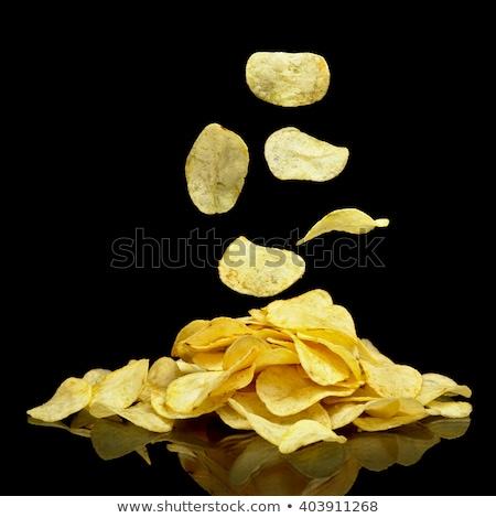 картофельные чипсы черный падение темно жира быстро Сток-фото © Alex9500