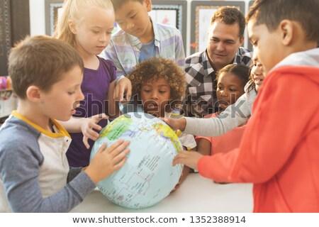 tanul · földrajz · portré · aranyos · osztálytársak · tanár - stock fotó © wavebreak_media