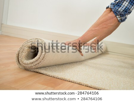 Worker's Hands Unrolling Carpet Stock photo © AndreyPopov