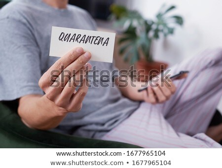 note with word quarantine in italian or catalan stock photo © nito