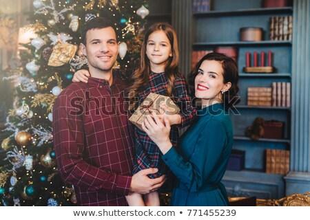 счастливая семья стоять вместе украшенный посмотреть Сток-фото © vkstudio