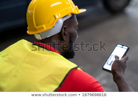 Worker looking at a building part Stock photo © photography33