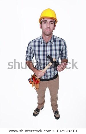craftsman holding hammer looking threatening stock photo © photography33