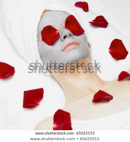 portrait of lying down woman with rose foils Stock photo © phbcz