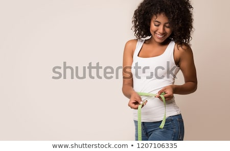 Beautiful fitness woman measuring waist Stock photo © AndreyPopov