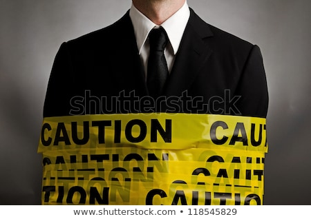 Businessman With Danger Tapes Stock photo © Voysla