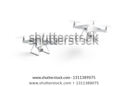 Quadrocopter with photo camera flying outdoors Stock photo © amok