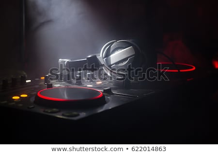 Dj mixing tracks on the party Stock photo © deandrobot