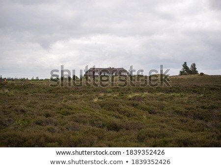Fenced farm house with picturesque landscape. Stock photo © iriana88w