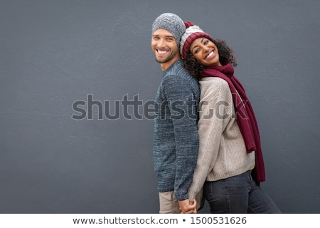 portrait of a multiethnic couple standing stock photo © deandrobot