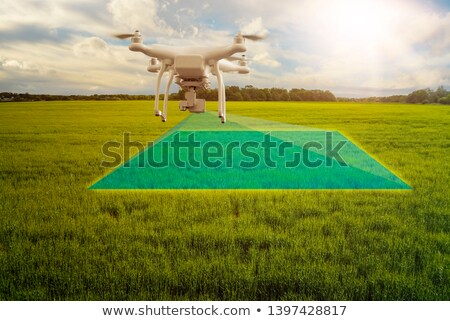 multicopter drone flying over crops field Stock photo © unkreatives