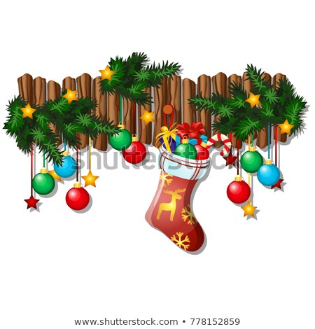 Wall Christmas decor with dangling baubles, fir branches, sock with gifts isolated on white backgrou Stock photo © Lady-Luck